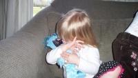 Aero gives her Dada  doll a kiss